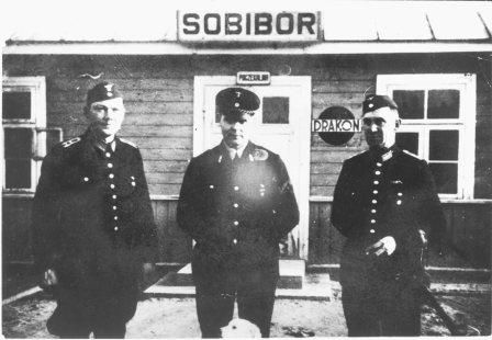 Railway personnel in front of the small station of Sobibor opposite the camp (photograph NIOD).